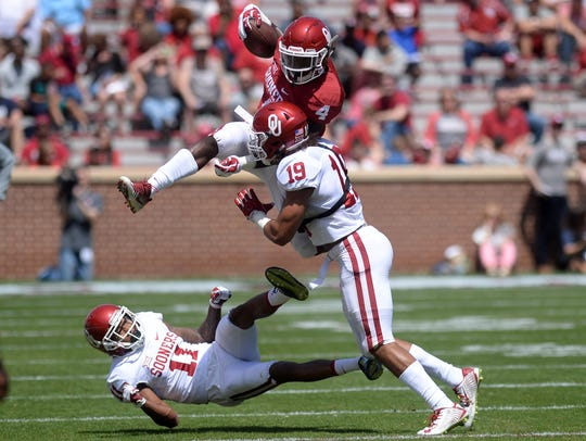 Oklahoma running back Trey Sermon attempts to hurdle