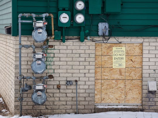 Four buildings along Veterans Drive were boarded up to keep occupants out in February 2016 after a string of ordinance violations and trespassing incidents.