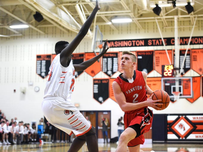 Yankton guard Ben Jurrens (2) drives to the basket