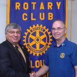 Greg Landry, left, of Rotary International Zone 31 and Opelousas Rotary Club member Bruce Gaudin at the weekly luncheon in June. Gaudin is one of the organizers of Tuesday's auction.