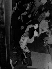 Paul Lawrence makes a leap to the wall during a Velcro jumping contest at Heaven nightclub in February 1992.