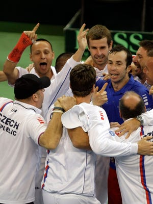 Members of the Czech national tennis team celebrate after clinching the Davis Cup title.
