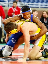 Catholic Central's Kevon Davneport (top) decisioned