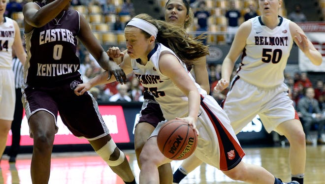 Belmont guard Darby Maggard, center, drives against Eastern Kentucky forward Jalen O'Bannon.