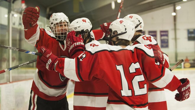 CVU celebrates a goal during a boys hockey game against South Burlington at Cairns Arena last season. The Redhawks are one of two remaining unbeaten teams in Vermont this winter.