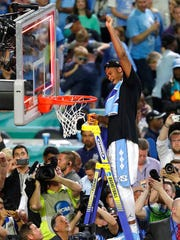North Carolina forward Isaiah Hicks cuts down the net after the championship game against Gonzaga at the Final Four NCAA college basketball tournament, Monday, April 3, 2017, in Glendale, Ariz. North Carolina 71-65.