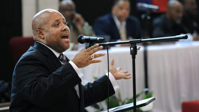 The Rev. Michael K. Jones talks April 19, 2012, about problems with racial profiling during the National Action Network's series of community conversations at the Progressive Baptist Church.