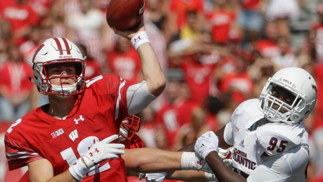 Wisconsin quarterback Alex Hornibrook throws while being pressured by Florida Atlantic's Ernest Bagner during last Saturday's game in Madison.