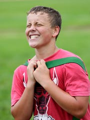 A Medford football player powers through pain to perform