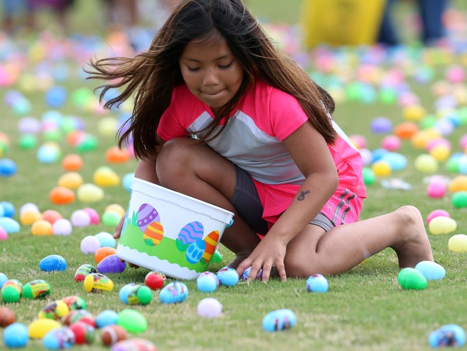 Children race to fill their basket with Easter eggs