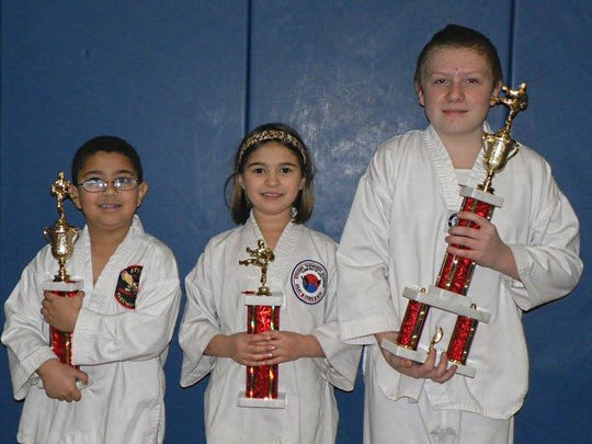 Zaid Alkasrawi, Samara Poirier, and Chandler Ludke recently received received trophies for excellence in testing from Stevens Taekwondo Academy.