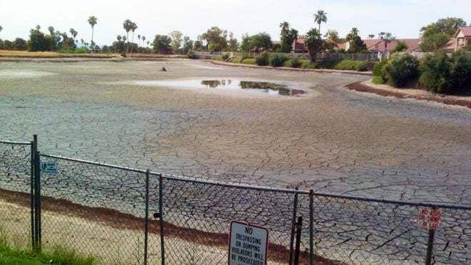 Ahwatukee eyesore: Patricia Carper said the once-attractive riparian pond at the former Ahwatukee Lakes Golf Club now looks like a moon landing in the middle of a residential area.