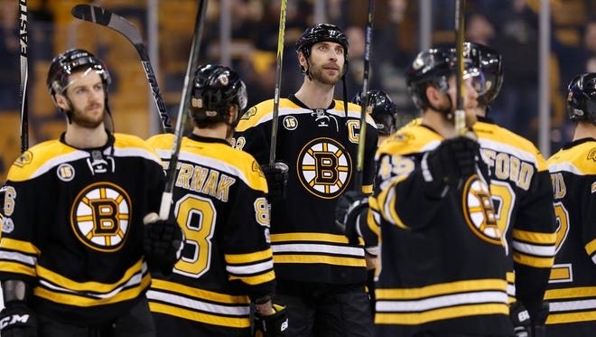 Boston Bruins defenseman Zdeno Chara (33) waves to the crowd after being defeated 3-2 by the Ottawa Senators in overtime of game six of the first round of the 2017 Stanley Cup Playoffs at TD Garden.