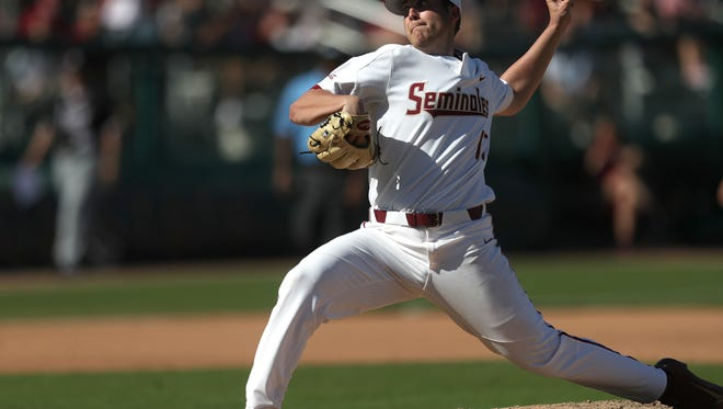 FSU's Jonah Scolaro pitches against Troy as the Seminoles stay undefeated on the year with a 6-5 win at Dick Howser Stadium on Saturday, Feb. 24, 2018.