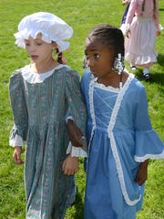 Our Lady of Victory School students Avery Faut (left)