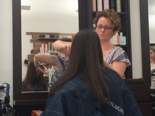 Blue Dahlia Salon owner Jamie Stuart cuts the hair of Mary Beth Berry, who was visiting from South Carolina.