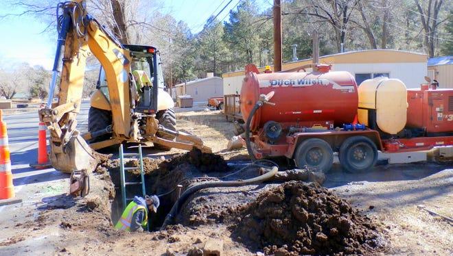 Crews work on a water leak in Ruidoso