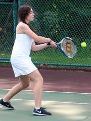 Cedar Grove's Haley Diess returns a serve.