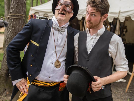 Steve Thompson and Gregory Dobbs show off their outfits at the Steam Dream Expo at The Olde World Village.