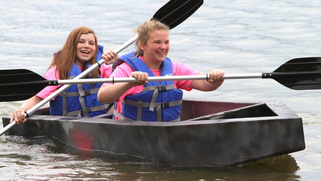Hailey LaDouceur and Jennacy Mullins take a Crouse -built craft out for a spin on Lake Walden prior the official Cardboard Regtta competition held Saturday at Waldenwoods.