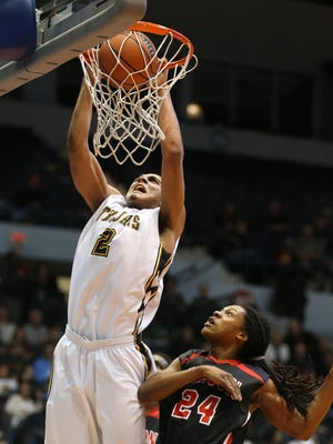 Athena's Anthony Lamb dunks the ball over Wilson's Donovan Campbell.