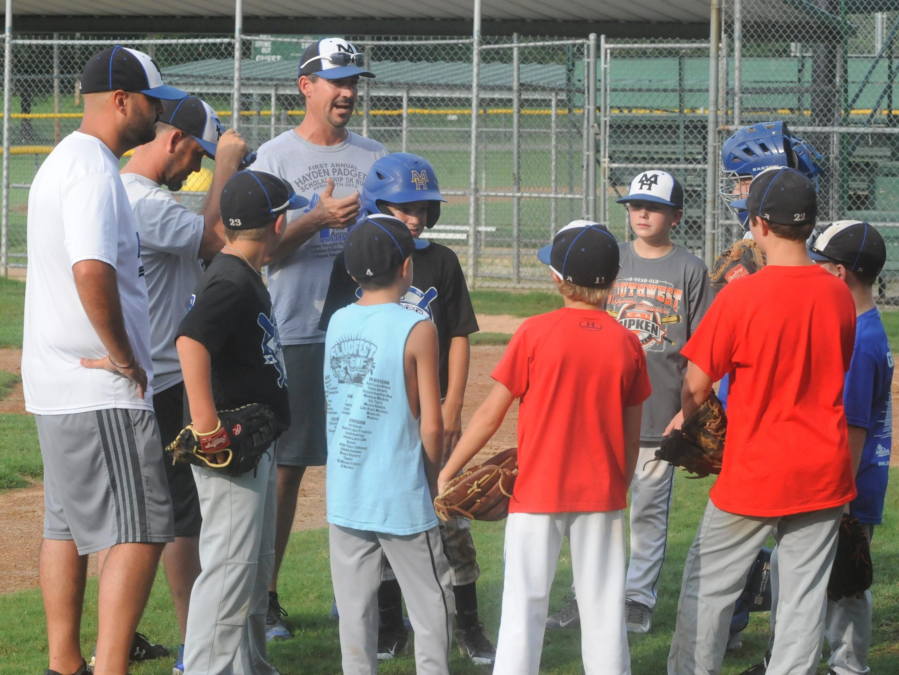Members of the Mountain Home Force 10-year-old all-star team listen to coach Tom Czanstkowski, fourth from left, before a recent practice at Clysta Willett Park. The team is playing at the Cal Ripken 10-year-old World Series in Jonesboro, beginning Aug. 8.