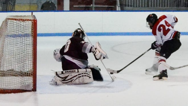 Rye forward Will Hynson (24) scores a short-handed goal for the Garnets in a 6-2 win over Scarsdale on Wednesday at Playland Ice Casino.