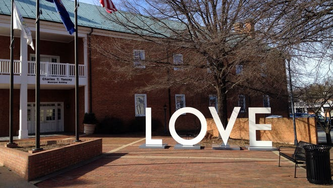 "The sun shines down on the Virginia is for Lovers ""LOVE"" artwork on display in front of Waynesboro City Hall on Monday, Feb. 13, 2012. The artwork will remain on display through Wednesday, Feb. 15."