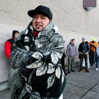 Steve Cervantes, 34, originally from California, bundles up with a blanket while waiting in line for the early Black Friday sale at Best Buy at Lancaster Mall in Salem on Thursday, Nov. 26, 2015. Cervantes bought a tent and sleeping bag on Monday night so he could be send in line, after seeing there was already one person waiting outside the store.