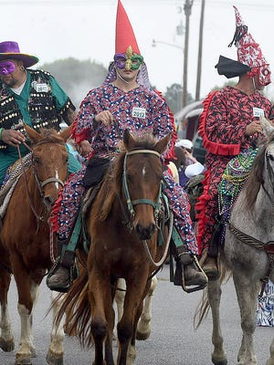 Masked riders line up near the Northwest Community Center for the start of the Eunice Courir de Mardi Gras. After an all day ride through the countryside collecting ingredients for a mass gumbo the riders returned with a parade down Second Street in downtown Eunice. See more photos of the event on the Daily World Facebook site.
