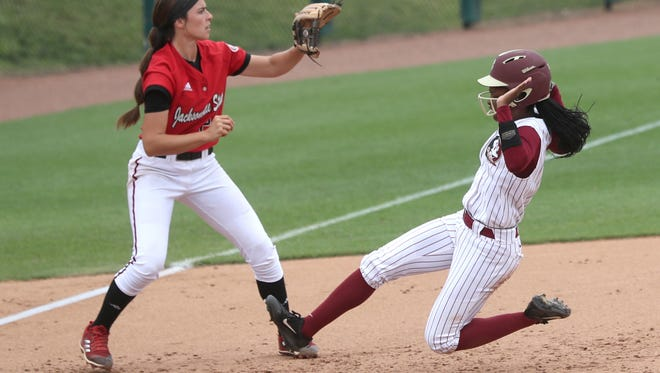 FSU's Deja Bush slides in safely at third base against Jacksonville State during the Seminole's 10-0 NCAA Regional Tournament win over the Gamecocks on Sunday, May 20, 2018.