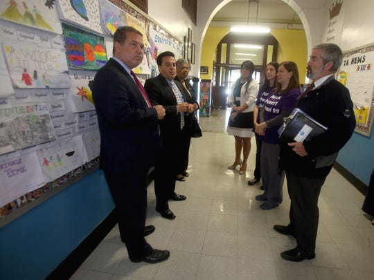 Yonkers Mayor Mike Spano and schools Superintendent Edwin Quezada, second from left, speak with John Carr, facilities manager for the Yonkers schools, during a tour of School 22 on Nepperhan Avenue.
