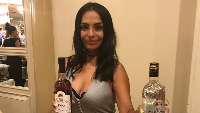 Orietta Fernandez of CATB Liquor Imports shares her wares at the Hispanic Business Expo on July 17 at Pines Manor in Edison. CATB was one of 147 vendors to participate among 1,200 attendees.