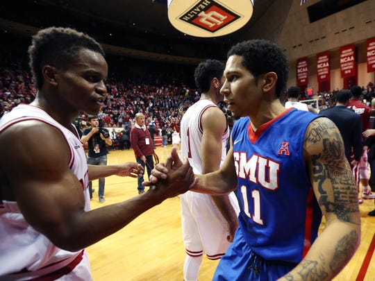 Nic Moore (right) talks with fellow former Indiana All-Star Yogi Ferrell after SMU's loss in Bloomington, Nov. 20, 2014.