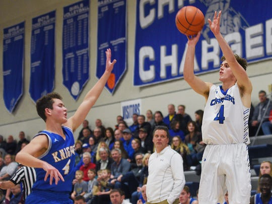 Sioux Falls Christian's Lincoln Unruh attempts to make a three pointer during the game against O'Gorman Tuesday, Jan. 2, at O'Gorman.