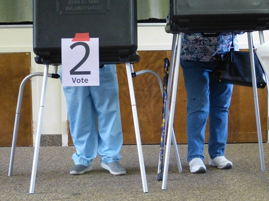 Two voters make their election choices Tuesday at St. James Lutheran Church in Redding.