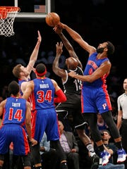 Pistons center Andre Drummond (0) defends Nets forward