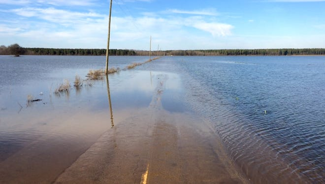Part of Coffee Landing Road in Hardin County is still covered with flood waters, Wednesday.