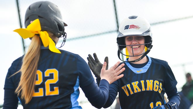 River Valley softball teammates Claire Nicholson (22) and Kylie Lang (10) greet each other during a game against Marion Harding last year. Both return for the Vikings this season.