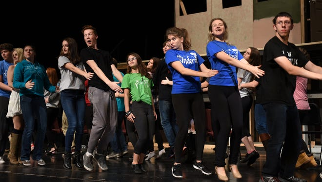Milford High students rehearse a scene from their production of The Addams Family.