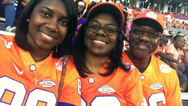 From left, Marcus Edmond's sister Ashley, mother Arnett and father Allen smile during Clemson's game at Florida State in 2016.