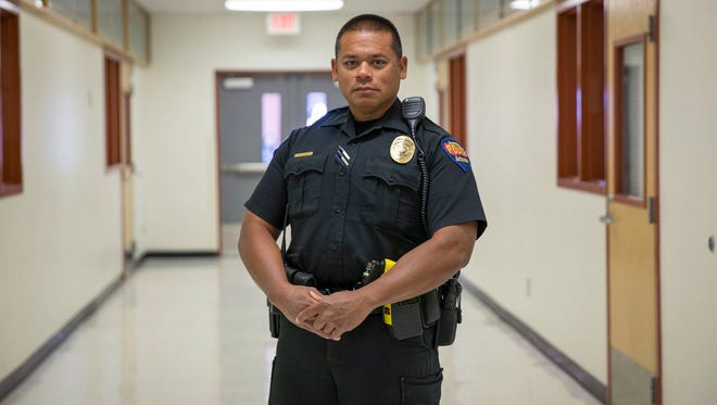 Police Officer Edward Toves keeps watch at Westview High School in Avondale.