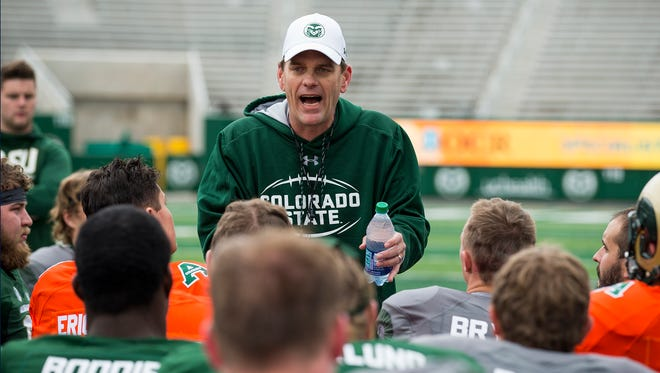 CSU football coach Mike Bobo talks to his team following the spring game on April 21.