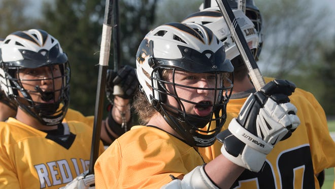 Red Lion JV player Kyler Reyes gets ready for play with teammates against Dallastown Monday May 7, 2018.