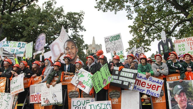 Fans rally in front of ESPN's cameras just north of Beaumont Tower at ESPN's College GameDay compound on Sept. 29, 2012.