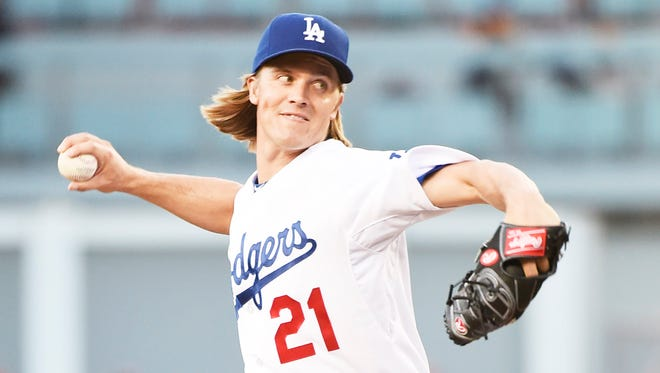 Los Angeles Dodgers starting pitcher Zack Greinke (21) works against the Philadelphia Phillies in the second inning at Dodger Stadium.