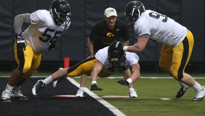 Josey Jewell, center, broke his hand in the week leading up to Iowa's 2014 football opener. He's been cleared for action this weekend against Iowa State if head coach Kirk Ferentz chooses to gve him playing time.