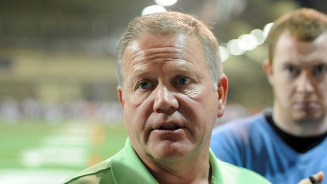 Notre Dame football coach Brian Kelly talks to media during football 101 a fund raiser for the Kelly Cares Foundation at the Loftus Center on the campus of the University of Notre Dame Tuesday June 10, 2014 in South Bend, Ind.