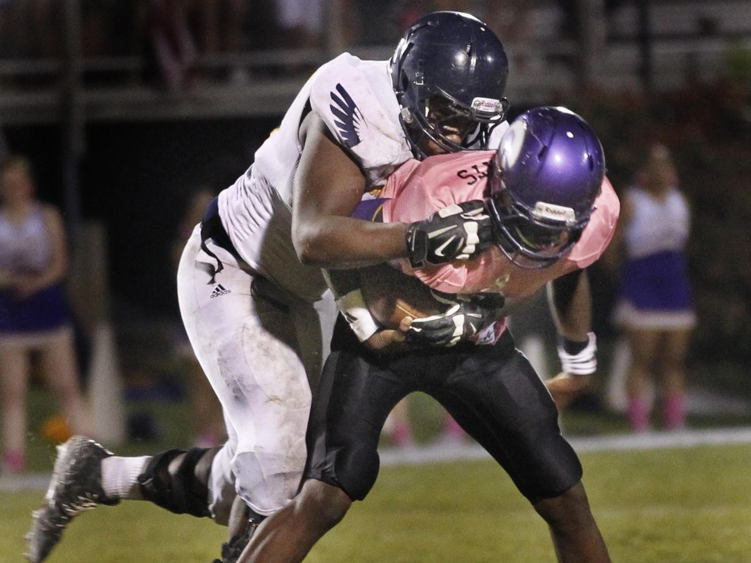 Rakavian Poydras, seen here playing for Northeast two years ago, tackles a Clarksville High player. Poydras, who now plays at CHS, has committed to play college football at the University of Memphis.