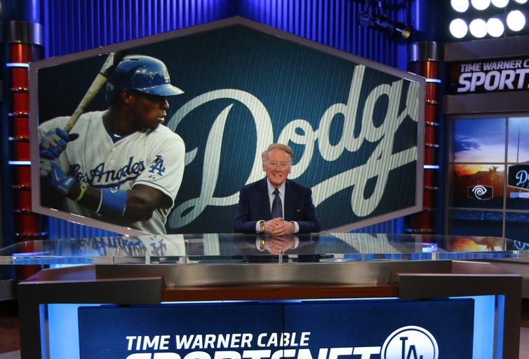Hall of Fame announcer Vin Scully is set to return to Los Angeles for his record 66th season with the Dodgers in 2015.